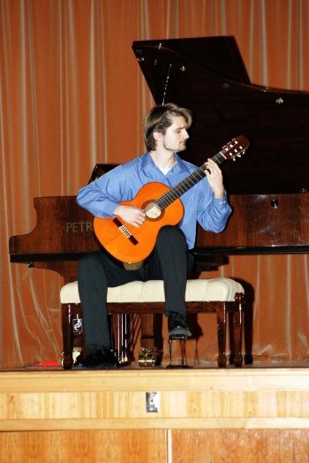 Damjan Rakonjac, classical guitarist during his performance.